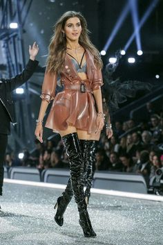 Transparent pink latex belted coat worn with black thigh high boots on runway.. DIY the look yourself: http://mjtrends.com/pins.php?name=transparent-latex-for-coat