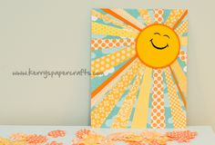 I like this concept.  I see a piece of sky scrapbook paper modge podged onto a canvas and the sun rays made out of ribbon wrapped around the edges.  I think I'll try it. :)