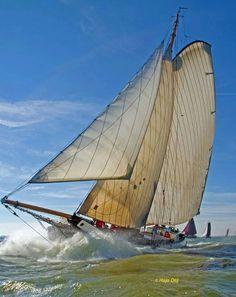 sailing under full sails vessel sailboat