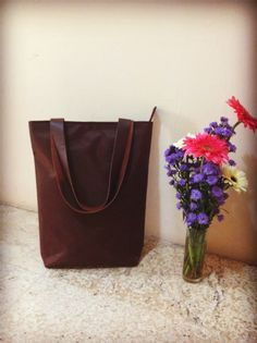 Totebag parachute brown colour with leather strap size 35 cm x 40 cm x 10 cm price IDR 180.000 cp: +62 81227800577