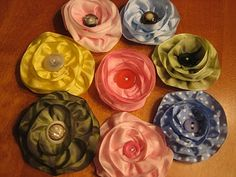 Ribbon flowers made with wired ribbon and vintage buttons . . . fabulous!