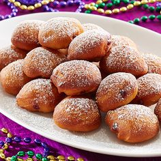Mini Beignets - The Pampered Chef®  Canola oil for frying (about 3 cups/750 mL)1 pkg (7.5 oz/212 g) refrigerated buttermilk biscuits (10 pieces)1/2 cup (125 mL) raspberry jam Powdered sugar for dusting