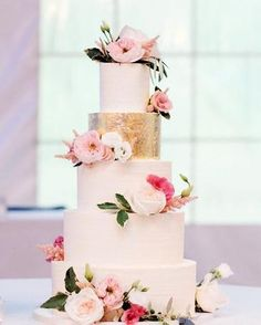 Buttercream cake with gold foil and fresh flowers from Frontier Flowers of Fontana at The Abbey Resort in Fontana, Wisconsin. Mindy Joy Photography  Jhttp://www.juliemichellecakes.com/gallery.html