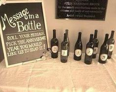 Perfect DIY fun! Get some old champagne bottles and paint them, then add the numbers, leave scrolls behind for your guests to write messages on, stick them into the bottles, every year open the correct bottle and read the sweet messages to each other, how fun
