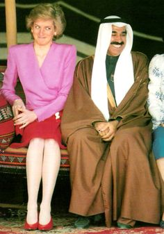 A shy smile from Diana, who shares the same chair with other people, who were members of the government of Kuwait. When Diana visited the country, a desert picnic was schedualed for her. During the picnic, she sat under a traditional tent and tasted traditional food as well! The princess visited kuwait on 1989.