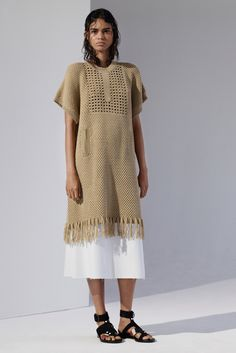 Okay the trim is knit, and I'm not sure about the body, but the sort of cross-shaped stitching on the front is crochet, yes? Thakoon Resort 2016