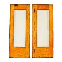 pair of original c. 1897 exterior chicago two-flat residential two-part or double door assembly comprised of varnished oak wood with beveled edge plate glass panes