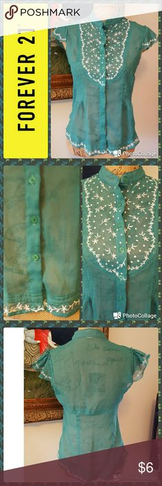 """Forever 21 sheer green embroidered blouse In good condition. Forever 21 top. Sheer green button down front. Mandarin collar. Flared cap sleeves. There is some unraveling on small area of collar  ( photo shown). Measurements are length 24"""", bust 35"""". Forever 21 Tops Blouses"""