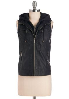 Chic Shortcut Vest. Well-versed in the quickest routes around town, you cruise in cool fashion sporting this black, vegan faux-leather hooded vest. #black #modcloth