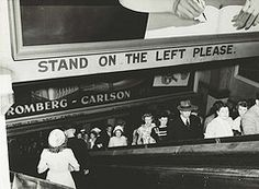 Rail commuters on the escalators at Wynyard Railway Station. Dated: 25 February 1948