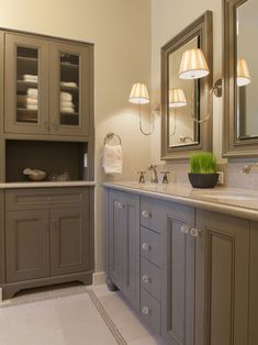 Grey Painted Bathroom Cabinets with glass knobs.