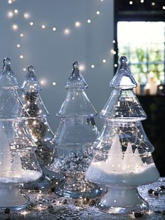 Made from strong glass shaped just like a Christmas Tree, this large clever vase can be filled with a variety of different festive treats for a really unique display. Simply lift the top third of the Christmas tree to reveal a hollow inside and fill with Christmas sweets, our Naked Wire Lights, or create a magical Winter display with our Decorative Snow and Minature Frosted Christmas Trees.