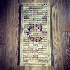- WINE CORK NOTICE BOARDS  Up-cycling at it's best! Unique pin boards filled with interesting wine bottle corks.  They are made to order with bespoke frames made from re-claimed wood.  Perfect as a gift or to pin your table plan onto.  Can be personalised as pictured with a letter of your choice in either portrait or landscape.