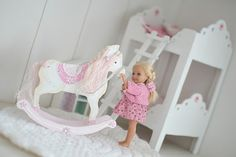 This post talks about making the rocking horse, but I like the bunk beds in the background