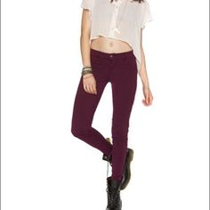 Brandy Melville Burgundy Maroon Skinny Jeans 42 3 Good condition. It's a burgundy maroon color. Size 42 which fits like a 3. Inner tag is a bit torn, I'm not sure if it came like that, I bought from another seller. I am a size 1 or 3 and they fit good in the legs but a little big in the waist/hips. Brandy Melville Jeans Skinny