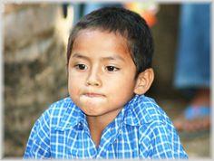 An El Salvadorian boy making a funny face.