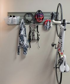 Create a storage solution for a bike in a small space with this unique organizer. Use the easy-to-install panel to turn a wall into a customizable canvas, then hang the bike vertically and stash gear on hooks and in bins. Includes 4' panel, five X-hooks, medium hard bin, vertical bike hook and installation accessoriesPanel: 48'' x 12'' HPVC / powder-coated steelImported