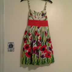 Gorgeous floral dress Easter Bust about 16 in across, empire waist about 12.5 in across, length about 34 in. Lined with tulle ruffle to give it some poof. Size 5 juniors. BCX Dresses