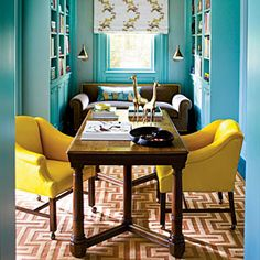 Aqua walls again, but this time the pop of brightness from the yellow chairs provides a welcome contrast to the overall room's colour. Maybe the aqua won't be as overwhelming if it were confined to just one feature wall.