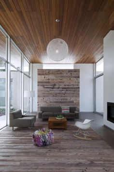 """This room is totally everything I love! White walls, wood, wall of windows, Eames rocker, and even my most cherished Random light! Just get rid of the horrid colorful """"pouf."""""""