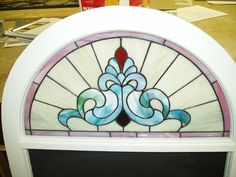 Cranberry Stained Glass custom work: Old window frame, Stained glass topper...now it is a blackboard. Private home.