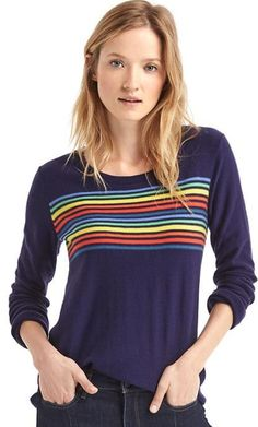 Gap Supersoft and fine Merino wool blend. Long sleeves with rib knit cuffs and hem. Round neckline. Multicolor stripe detail at front. Straight silhouette with an easy ...