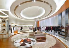 """EMPHASIS.  A force or intensity of expression that gives impressiveness or importance to something. Wow this would be a hard ceiling to miss. designed by Front Inc of New York, echoing """"curved"""" interiors from the Louis Vuitton architecture team in Paris."""