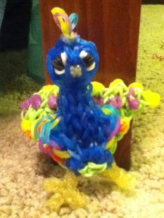 Rubber band peacock charm If you want to make go to YouTube and search rainbow loom peacock charm. It should be around an hour long video. It is long but worth it.