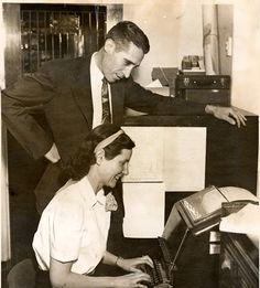 Policewoman Mary Muir and Chief Walter Heebing demonstrating the San Fernando Police Department's new teletype machine, that linked the Police Department directly to Los Angeles sheriff's office for the first time, 1949. San Fernando Valley History Digital Library.