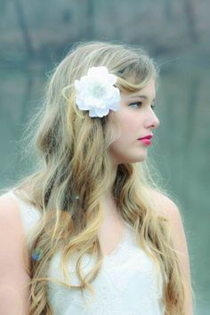 boho wedding hairstyle with flower clip