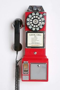 Loving this wall phone. // pop of #red // vintage #decor