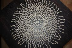 macrame tablecloth made of thin hemp thread.