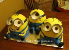 """Homemade Despicable Me Minion Birthday Cake: These are my little minions! Each one is made of two 6"""" rounds covered in yellow fondant and decorated with gum paste details. The goggles I made the night"""