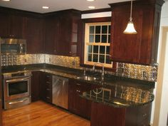 Red mahogany cabinets with black countertop