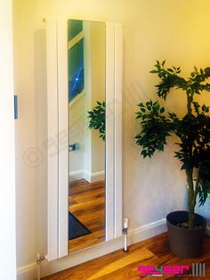 """Geyser """"EMPOLI"""" Bianco, White Designer Mirror Radiator, Hallways, Plant, Wooden Floor"""