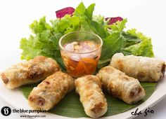 cha gio - deep fried spring rolls deep fried rice paper filled with seasoned minced pork and garlic, served with nuoc - mam sauce