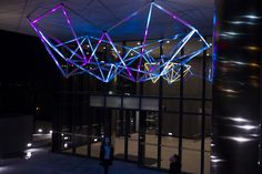 Symbiotica (KIT WEBSTER) is a geometric light sculpture expressing a symbiosis of ecology and technology, with connotations of both natural abode and high-tech home developed for the Imperial Doncaster apartment complex in Melbourne.