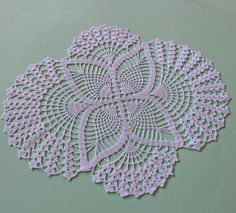 Hand crochet white table runner. This beautiful doily will be perfect accent for your dinner table or can be a lovely present for your dearest. It is made from 100% cotton yarns. Diameter about 14,17 x 17,32 (36 x 44 cm). If you would like to have such a doily, but in different color,