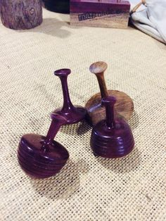 Purple Heart and walnut spinning tops