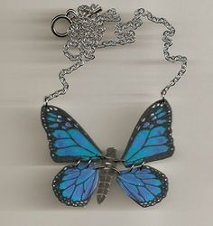 I loves this blue butterfly necklace. the wings move.
