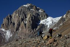 Aconcagua (Argentina). 'The tallest peak in the western hemisphere is an awe-inspiring sight, even if you're not planning on climbing it. People come from all over the world to do so, though – it's not a task to be taken lightly, but if you can take the time to train and acclimatize and you're good enough to reach the top, you'll be one of a select group who have touched the 'roof of the Americas.' http://www.lonelyplanet.com/argentina/central-argentina/parque-provincial-aconcagua