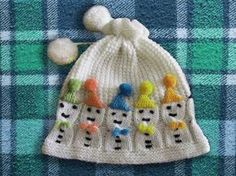 I would knit the hats red and green or just one color.