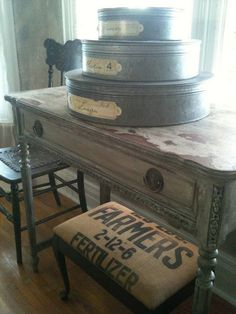 Primitive decor- love everything!  The metal containers with labels, the table, the stool!  Love it all!