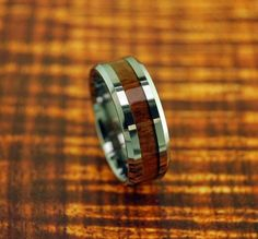Tungsten Carbide Koa Wood Ring 8MM - Wedding Band - Gift Idea - Promise/Engagement Ring - Father's Day Gift Idea by Silvershowroom on Etsy https://www.etsy.com/listing/155670799/tungsten-carbide-koa-wood-ring-8mm