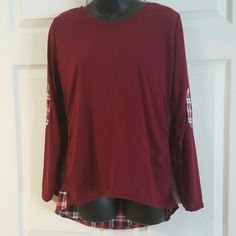 Burgandy hi-low with plaid accents. Comfy long sleeve hi-low top with plaid patches on elbows and tail of shirt. Price firm unless bundled. Boutique  Tops