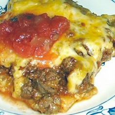 ENCHILADA BAKE - Low Carb.....I used a 10 oz can of sauce. Very tasty and will make again many times. Perfect with side salad,