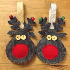 Denim reindeer tree decorations with hand-painted names on the reverse.