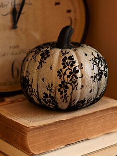 Good idea for an old-fashioned/Gothic/Victorian-themed Halloween Party - a white pumpkin wrapped in black lace tights!
