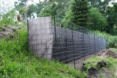 How To Inexpensively Solve Your Sloped Backyard Problems backyard ideas for gabion walls, concrete masonry, gardening, outdoor living Gabion Retaining Wall, Backyard Retaining Walls, Sloped Yard, Sloped Backyard, Steep Backyard, Landscaping With Rocks, Backyard Landscaping, Backyard Ideas, Garden Ideas