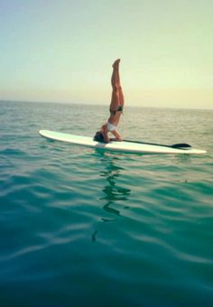 Handstand with a paddle.  So many SUP yoga pictures do not show the paddle, and that bothers me.